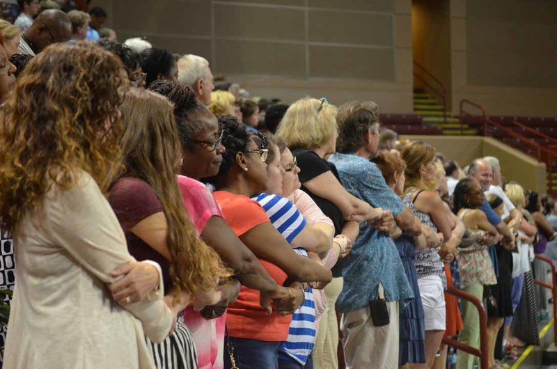 Attendees of the City of Charleston's prayer vigil standing hand-in-hand, June 19, 2015, Charleston, South Carolina, courtesy of ABC New4 WCIV-TV.