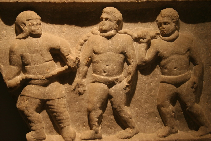 Roman collared slaves, marble relief, Smyrna (present day Izmir, Turkey), 200 A.D., courtesy of the Ashmolean Museum.