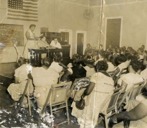 """<p class=""""ColorfulList-Accent11"""">Local 15 union meeting with Marie Hodges and Nan Carter<span>, Charleston, South Carolina, ca. 1950s, courtesy of&nbsp;</span>Georgia State University, Southern Labor Archives<span>.</span></p>"""