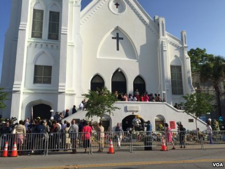 People gathered ahead of worship services at the Mother Emanuel AME Church, photograph by Jerome Socolovsky for Voices of America, Charleston, South Carolina, June 21, 2015.