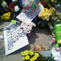 <br /> Flowers and signs left by visitors at the Emanuel AME Church, photograph by Toni Carrier, June 23, 2015, Charleston, South Carolina.