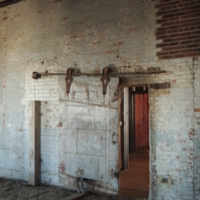 Fireproof door inside the Cigar Factory, photograph by Harry Egner, Charleston, South Carolina, February 2015.