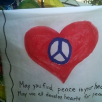 Sign left by visitors at the Emanuel AME Church, photograph by Toni Carrier, June 29, 2015, Charleston, South Carolina.