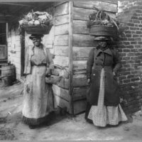 African American Women carrying baskets on heads.jpg