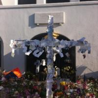 Cross covered in notes and prayers outside the Emanuel AME Church, photograph by Mary Battle, June 22, 2015, Charleston, South Carolina.