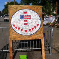 Wooden board filled with notes to the victims, their families, and Emanuel AME Church members, photograph by Meg Moughan, July 7, 2015, Charleston, South Carolina.