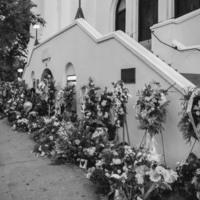 Flowers left at the Emanuel AME Church, photograph by Brandon Coffey, June 29, 2015, Charleston, South Carolina.