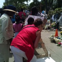 Visitors sign different boards created in honor of the Emanuel AME Church shooting victims, photograph by Toni Carrier, June 23, 2015, Charleston, South Carolina.