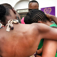 Visitors outside the Emanuel AME Church embrace each other, June 25, 2015, Charleston, South Carolina, courtesy of ABC New4 WCIV-TV.
