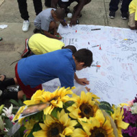 Hundreds of people, including many young people, signed posters for Emanuel AME Church, June 25, 2015, Charleston, South Carolina, courtesy of ABC New4 WCIV-TV staff.