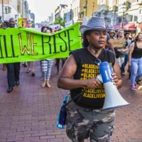 Black Lives Matter marchers on their way to the Daughters of the Confederacy building on Meeting Street, photograph by Hunter Boone, June 20, 2015, Charleston, South Carolina.