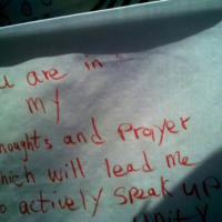 A message left on cloth at the Emanuel AME Church, photograph by Toni Carrier, June 29, 2015, Charleston, South Carolina.